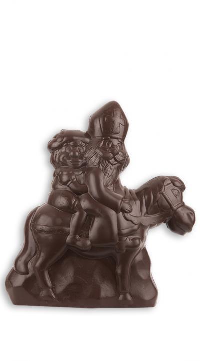 Sinterklaas en zwarte piet op paard in holle chocolade - fondant.